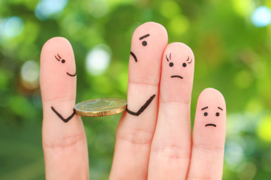 a hand with faces drawn on each finger and a coin between the mother and father finger. The two littlest fingers are beside the father. This is a metaphor for the fighting that can happen when a relationship with kids ends.